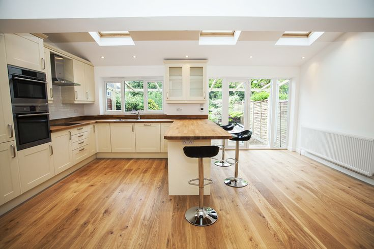 Kitchen extension - ideal layout with breakfast bar and skylights - with added bi-fold doors
