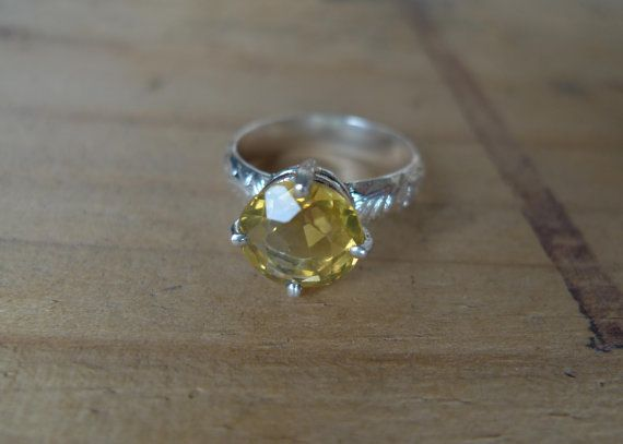 For the gal who loves a little sparkle! Lock & Found Cocktail rings! #slashpiledesigns This one of a kind ring features Light Yellow Citrine on a sterling silver floral band. All lost & found stones are reclaimed from melted down jewellery.  #giftguide