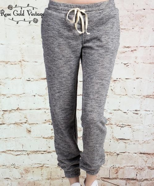 Every girl needs a great pair of cozy joggers! Elasticized at the waist and bottom hems, back patch pockets. Super soft french terry. Available in Charcoal Gray, or Blush Pink. Recommended sizing: Sma