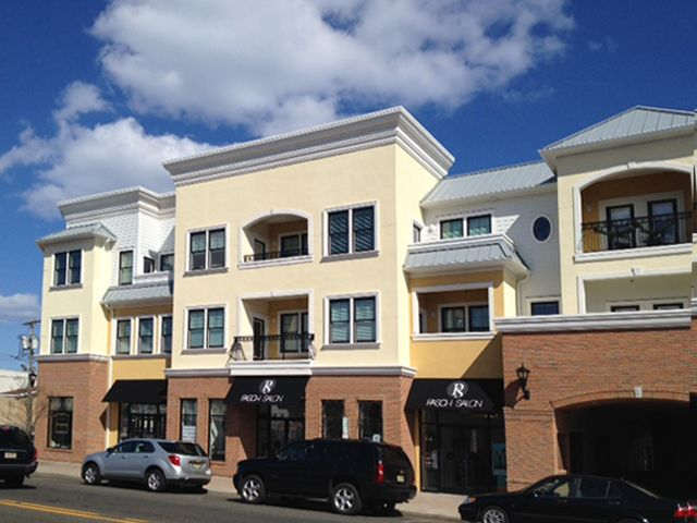 Sea Coast Commons - Mixed-use commercial and luxury apartment building featuring Windsor Pinnacle Wood/ Clad Double Hung windows with factory painted interiors and between-the-glass grilles.