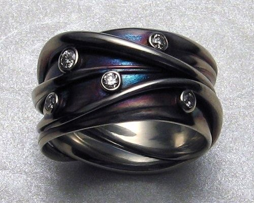 Ring by James Morton. Diamonds set on 14k white gold with iridescent patinas.