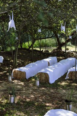 ShWe used a plain stretch white material top cover the haybales and prevent people from getting spiked or wet
