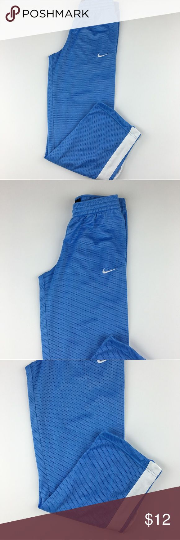 Nike basketball pants Sz Medium Nike basketball pants Sz Medium. Gently worn in great condition except for stains on back bottom of pants. Nike Pants Sweatpants & Joggers