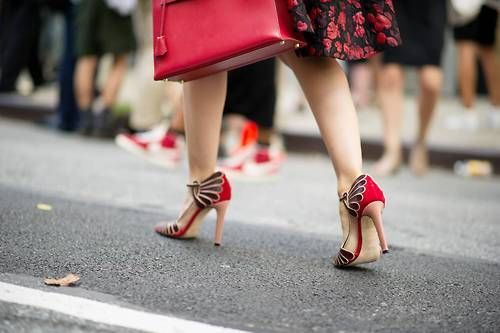 Matching red jewel tones makes an awesome street style. Michelle Harper wearing Chrissie Morris