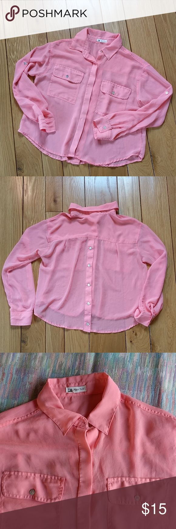"""Pink Cotton Candy see through blouse Semi see through blouse with hidden buttons in the front and great buttons down the back.  A great pink color that will be great in spring and summer.  Loose fitting and lightweight material.  Color closest to the pictures with the pink fabric background.  Measurements 20"""" flat across under the armpits, 22"""" length. cotton candy Tops Button Down Shirts"""