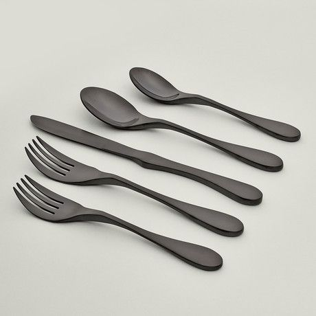 A titanium finish coats the utensils of this finely-crafted Black Titanium 5-Piece Place Setting in a matte black finish. Dishwasher safe and extremely durable, it's a triumph of functionality and modern industrial design.