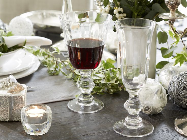 Christmas Table Setting | Silver decorations, crystal tea light holders and Ivy, used here to create an enchanted woodland themed Christmas table. Pictured: Brissi's silver present decoration, Emma Crystal Tea Light Holder and Renaissance Glassware #christmastable #tablesetting