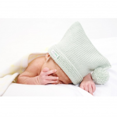 Great for him or her. Hat can be worn with the edge folded up or left down - fluffy pompom on one side.  Sizes: 0-6 & 6-12 months  Colours: natural, mushroom , pink , blue & sage