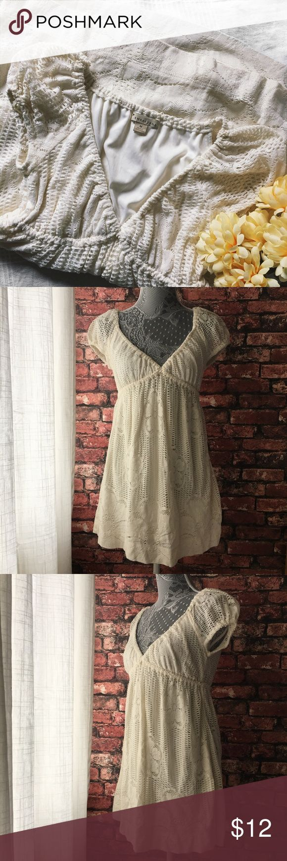 Forever 21 Lace Sundress The perfect cream sundress with cute lace details and a cream lining inside. Nice spring and summer time piece for your wardrobe. Perfect for a warm vacation or a day at the beach.  In good condition.  85% Cotton 15% Nylon Lining 100% Polyester  Made in Guatemala   Sleeves 6.5in Bust 18in Length 30.5 (Measured from Shoulders) Forever 21 Dresses