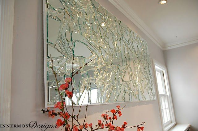 This cracked glass mirror is classy and unique, and will go well with any décor style!