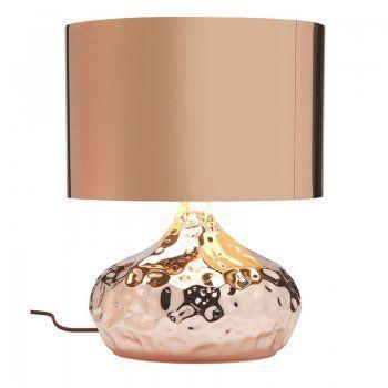 Een bijzonder mooie tafellamp van het merk Kare-Design.De lamp is erg opvallend door ijn mooie glimmende kleur