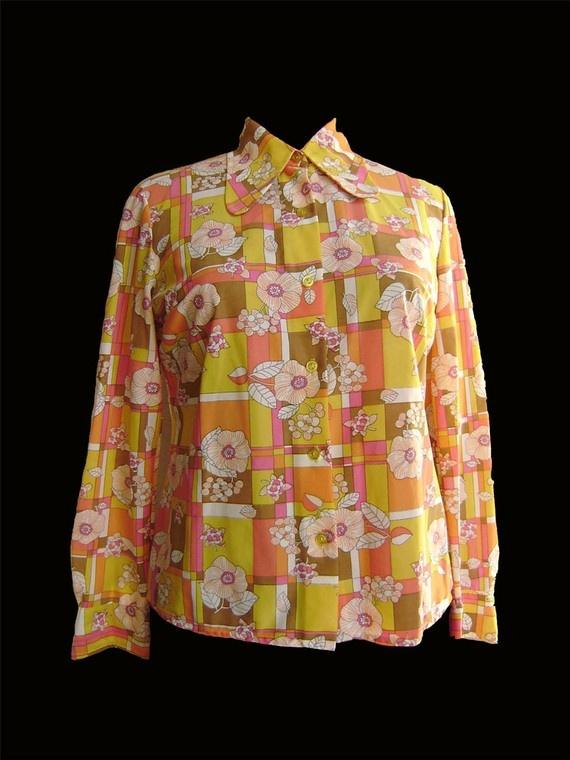 https://www.etsy.com/listing/50020356/60s-blouse?