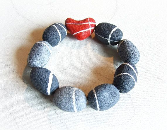 Heart stone bracelet Sea pebbles jewelry  by Sognoametista  To the center of the bracelet I created a pebble of a beautiful intense red .. because even the hearts of stone sooner or later fall in love !