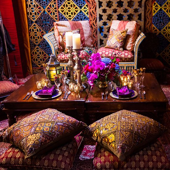 Steer your magic carpet toward this Disney's Aladdin inspired reception dripping in jewel tones and gold embellishments