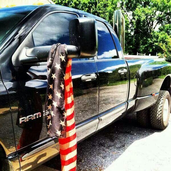 black dodge ram lifted  Cummings diesel duallie truck