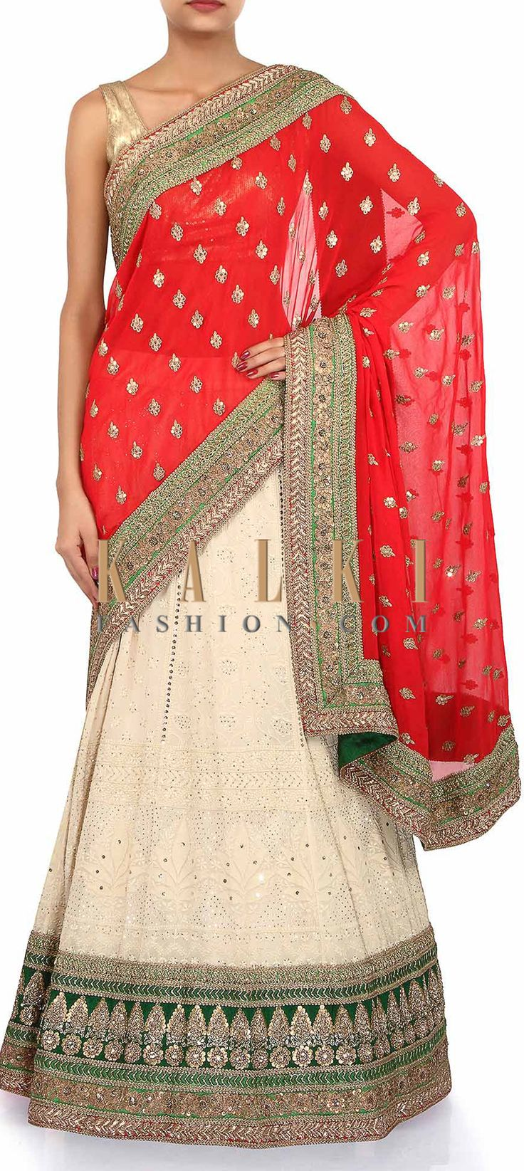 Buy Online from the link below. We ship worldwide (Free Shipping over US$100). Product SKU - 262172. Product Link - http://www.kalkifashion.com/half-and-half-lehenga-saree-in-red-and-cream-adorn-in-lucknowi-thread-embroidery-only-on-kalki.html