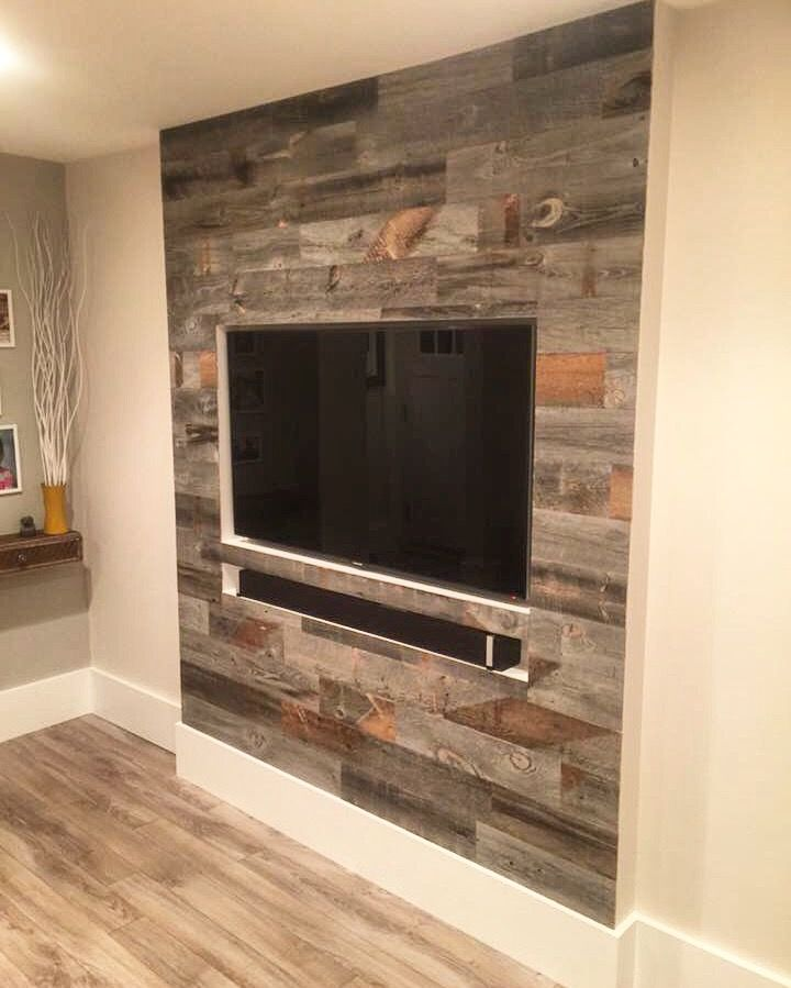 A recessed TV wall with a Stikwood accent. SO neat!