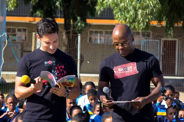 Danny K and Kabelo read to the learners