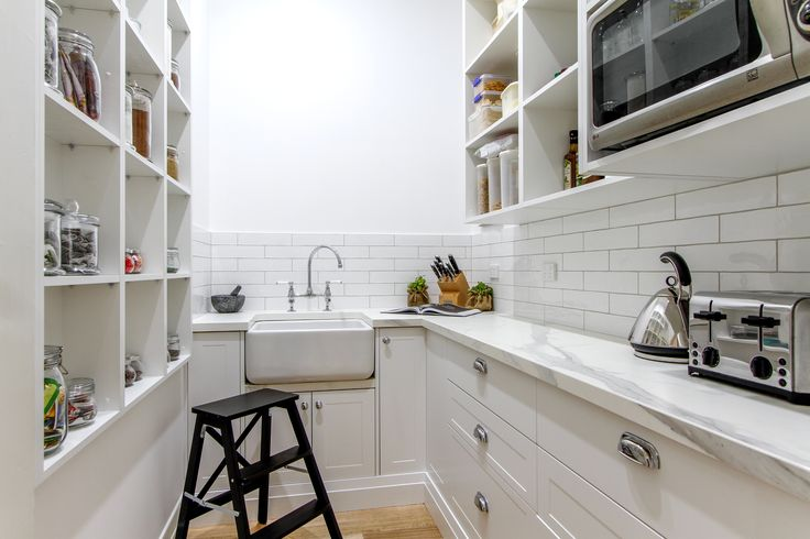 Subway tiles, Belfast sink and custom made cabinetry.