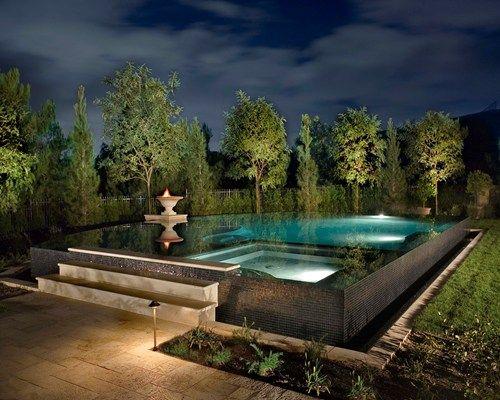 Infinity Pools. Tree up lighting around the back .   Home ...