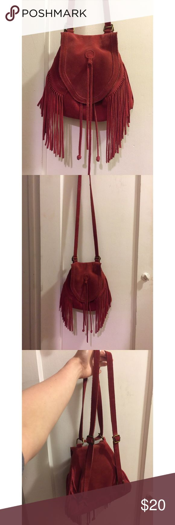 Red suede urban outfitters bag Red suede urban outfitters bag can be used as a satchel, or backpack or purse. Is a little worn but still looks in great condition. Urban Outfitters Bags Satchels