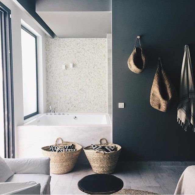 Black accent wall in bathroom.