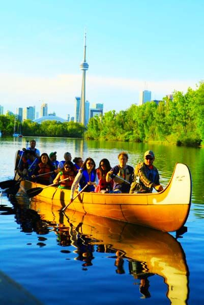 Visit to the Toronto Islands by this 36' Montreal Voyageur Canoe.