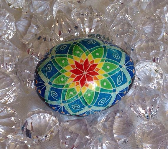 This is a beautiful traditional multi-coloured Pysanky egg . The egg has been dyed using the the traditional Ukrainian batik method. Designs are created by applying dyes in layers using melted beeswax. Upon completion, the egg is covered with a thin layer of clear gloss urethane, blown