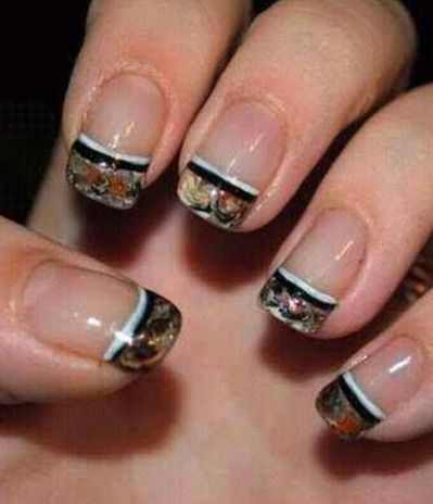Maybe I'd go with a manicure like this for my nails since I don't think I want to wear all that much camo myself at my wedding, since I kinda want to stick with wearing a more traditional wedding dress. These could be a nice accent to go with the other camo I want in the wedding though!