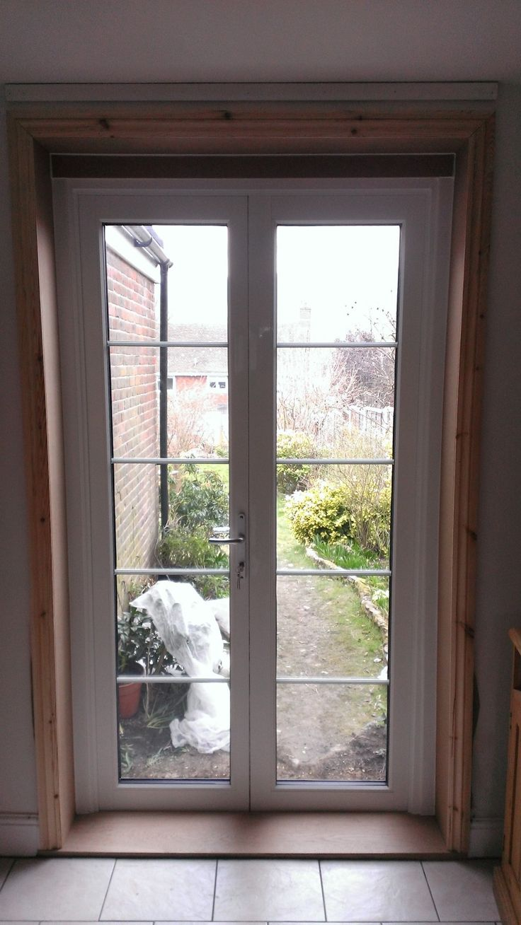 An aluminium French door with external Georgian bars.  We replaced the timber surround too.