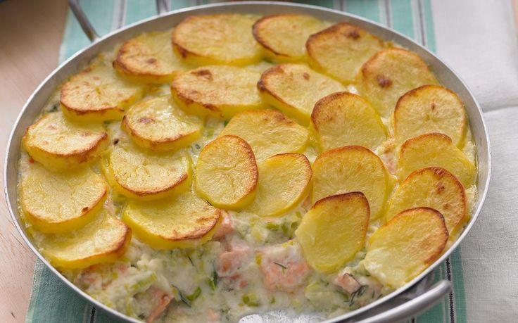 Crisp potato hides a succulent mixture of salmon and fish in this impressive pie.