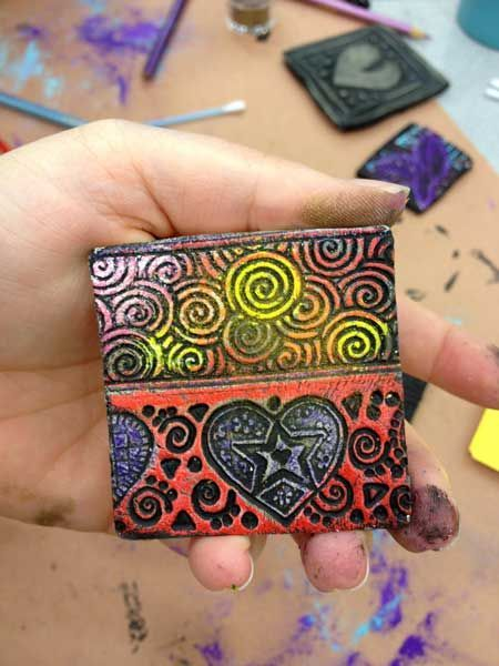 Great ideas for painting clay without glaze.  http://artsmudge.com/2012/08/non-traditional-glazing-techniques-for-elementary-art/