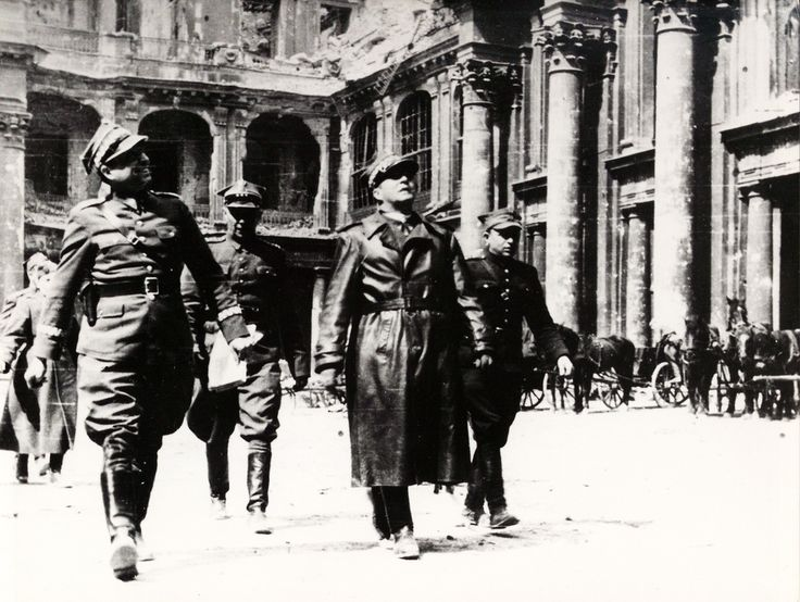 1945 Battle of Berlin - Polish People's Army generals Michał Rola-Żymierski (center, in leather trenchcoat) and Marian Spychalski (right) walking victoriously through the streets of Berlin.