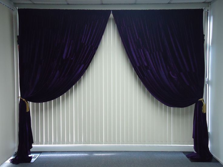 Give your venue a royalty feel with a dark purple backdrop. #event #backdrop #decor