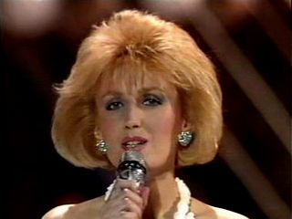 1985 Eurovision UK Entry (No. 4) Love Is - Vikki Watson. 'Love Is', written and composed by James Kaleth and Vikki Watson, was the United Kingdom's entry at the Eurovision Song Contest 1985, performed by the latter composer, Vikki Watson, credited at Eurovision and on the single as Vikki. The first female soloist to compete for UK at Eurovision since Olivia Newton-John with 'Long Live Love' at Eurovision 1974 and also the first…