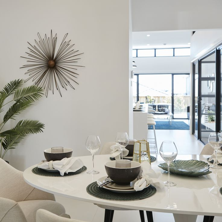 #diningarea #openplanliving #indoorplants #natural #white #cream #tablesettings #placesetting #diningtable