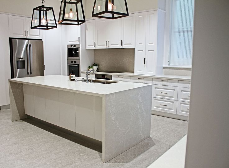 Kerry Selby Brown Design featuring Caesarstone Alpine Mist island bench top.