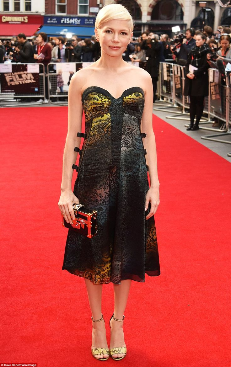 Stunning: Michelle Williams, 36, dazzled in a sparkling snake-skin chiffon gown as she attended the premiere of her new film Manchester By The Sea at the BFI London Film Festival on Saturday night