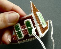This tutorial might help me make my plastic canvas house ornament since there are no instructions for the ornament I picked.