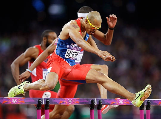Dominican Republic's Felix Sanchez clears a hurdle in the men's 400-meter hurdles final Monday, Aug. 6. Sanchez won gold in the event for the second time, matching his feat from the 2004 Athens Games.
