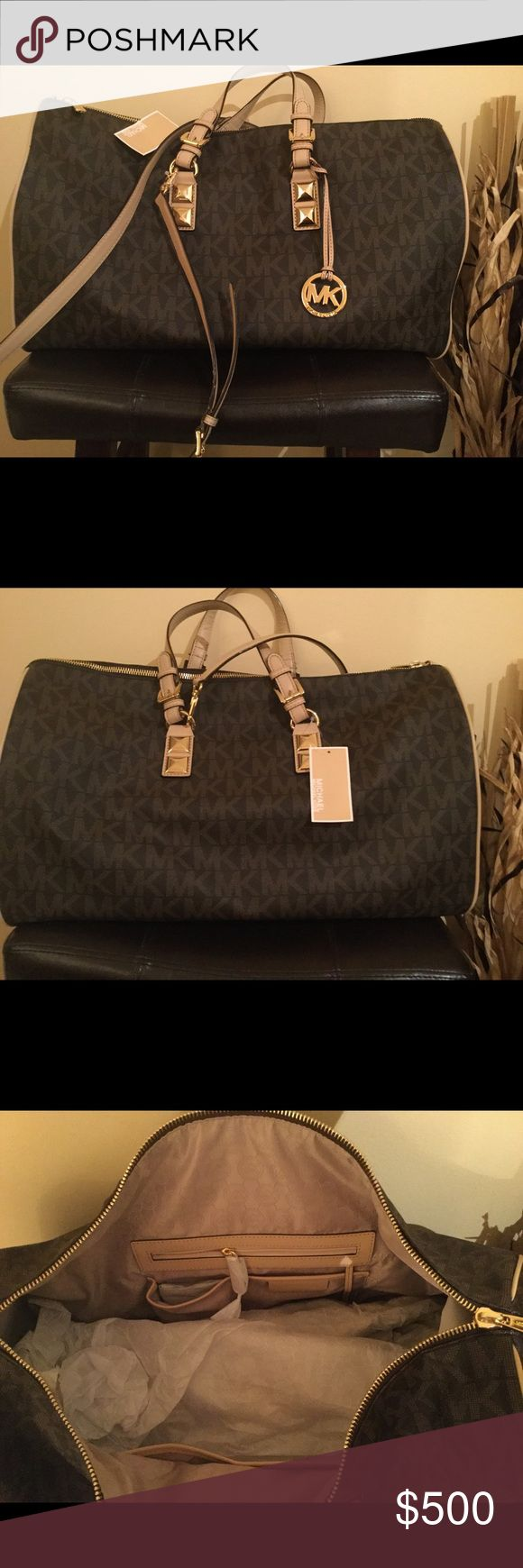 "New MK Grayson signature brown duffle 20""x14""x7""x9 New MK Grayson signature leather brown duffle bag . Price firm . No trades !! MICHAEL Michael Kors Bags Travel Bags"