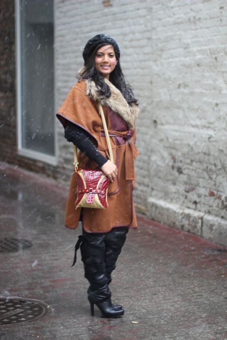 Chicago's Best Winter Street Style In 25 Chic Snaps! #refinery29  http://www.refinery29.com/26456#slide13  Sheetal Patel designs G.I.A. Luxe bags, but she caught our eye because of that gorgeous belted coat.   Photographed by Amy Creyer