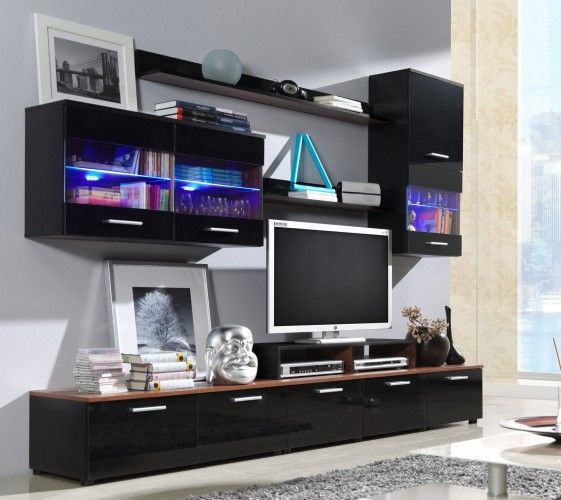 Obývací stěna Logo II rozzáří váš interiér díky použitému dekoru v matném i lesklém provedení. Minimalistické úchyty společně s předními plochami ve vysokém...