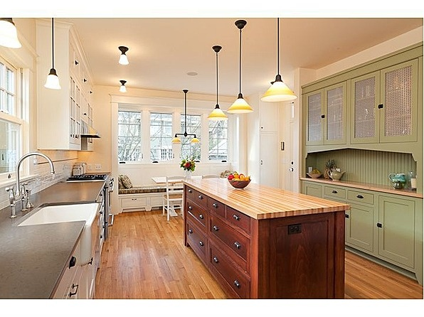Love the green cabinets! This is a craftsman bungalow in Portland.
