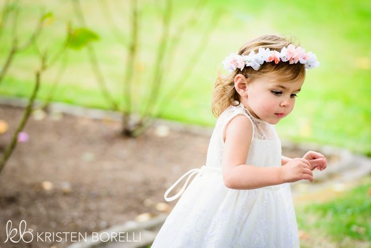 Flower girl wearing a floral crown.