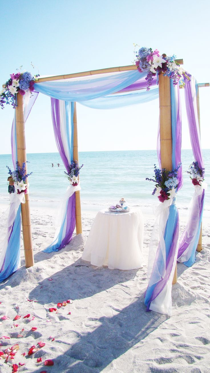 light blue and purple beach wedding arch