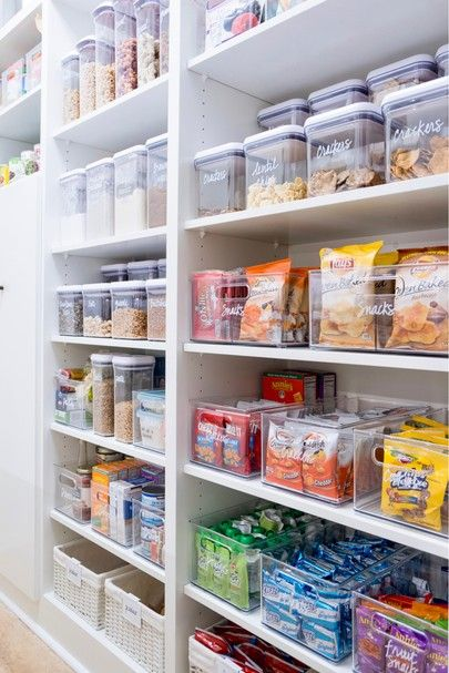 "We've done a lottttttt of pantries over the years, but this one is a recent favorite. Snacks in bins, cereal and grains in canisters, and rainbowfied because of course. Products and custom labels are linked on our shop page [thehomeedit.com/shop]! Just click the image under ""shop the feed"" - or scroll down to shop all our favorite products by category. // You can also shop via screenshot using the new @liketoknow.it app // http://liketk.it/2sGF7 ✨ #thehomeedit #pantry #organization #liketkit"