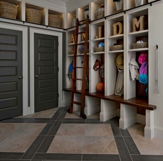 Walk in closet  from garage.Make sections for each person,and extra for umbrellas, torches, emergency lights etc