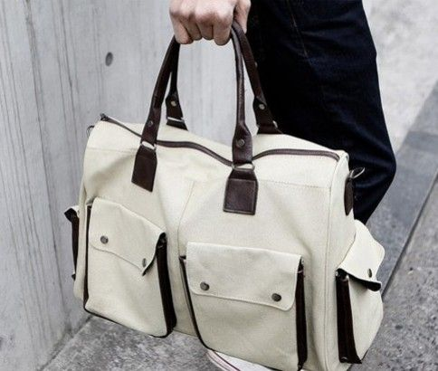 Canvas Shoulder Bag delivered to you for just $39!! Available in Black & White, which features 2 clip-on front pockets and 2 clip-on side pockets!! Go Easy ...   #ikoaladeals #dailydeals #fashion