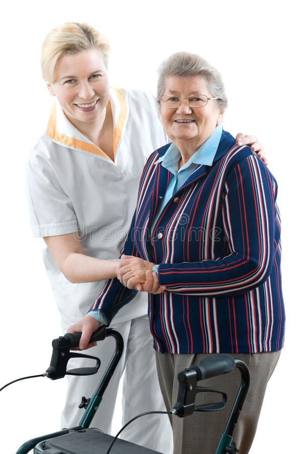 Nursing Home Doctor Or Caregiver And Senior Woman With A Walker